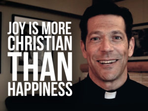 Fr. Mike Schmitz with text Joy is More Christian than Happiness
