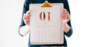 woman holds calendar for January