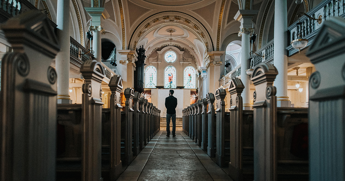 man standing near the alter in a Church